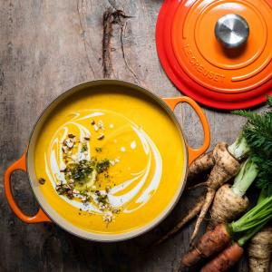 Flatlay of a carrot soup in a Le Creuset pot