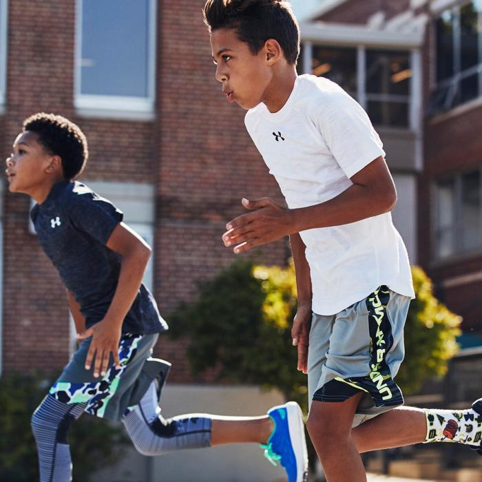 Two boys running in monochrome sportwear