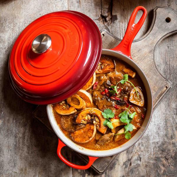Flatlay of a root veg stew in a Le Creuset pot
